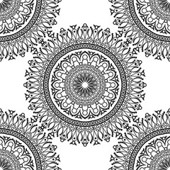 Seamless pattern. Mandala with decorative ornament.