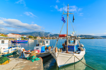 Greek fishing boats mooring in port in early morning, Samos island, Greece