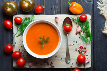 Tomato soup on a wooden table