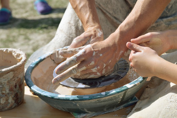 Potters working by the throwing wheel