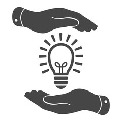 two hands protecting black idea light lamp bulb icon on a white