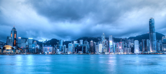 Sunset's Blue Hour Over Victoria Harbor in Hong Kong. Taken from Tsim Sha Tsui on Hong Kong Island. HDR rendering.
