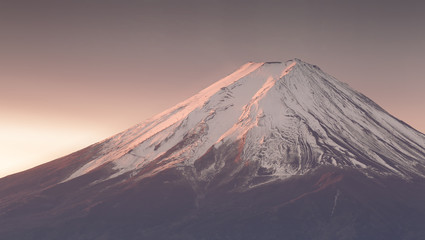 Top of Mt. Fuji with snow before sunrise in winter season