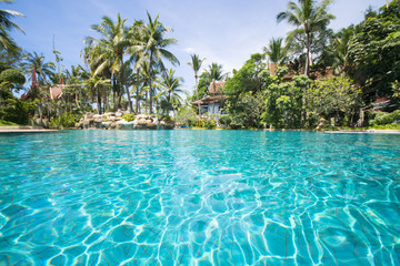 big swimming pool in tropical resort