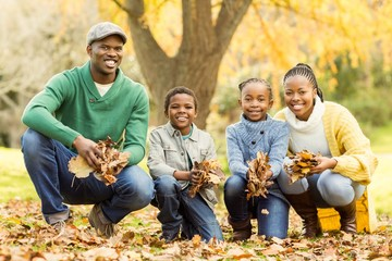 Portrait of young family holding leaves