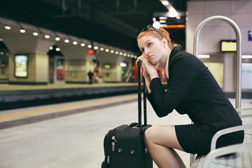 Bored businesswoman waiting train