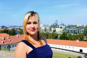 Beautiful girl in Vilnius town on Gediminas castle hill