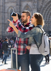 Happy tourists seeing sights