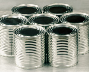 Tin cans for food on aluminum background, Selective focus and color effect