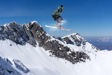 Flying skier on mountains, extreme sport