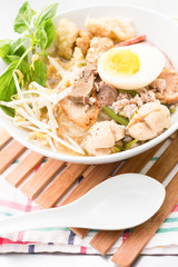 Pork rice noodle soup with meat ball, egg and vegetable
