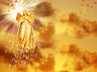 Wall Mural - an angel statue over mystical sky with divine light and stars