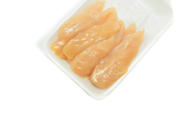 raw chicken meat in plastic tray  on white background