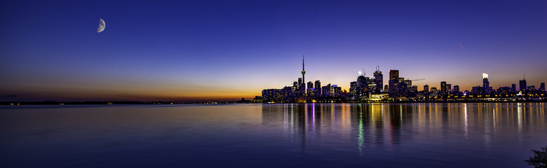 Mon over beautiful sunset in Toronto