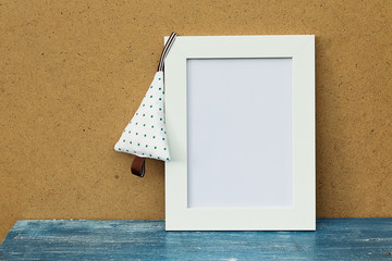 White empty frame on the table