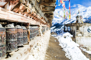 Travel to Nepal, Prayer wheels in high Himalaya Mountains, Nepal village