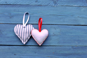 Two hearts on blue  wooden background