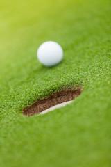 Golf ball on the edge of hole