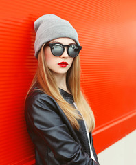 Fashion portrait stylish woman wearing a rock black leather jack