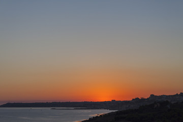 Sunset over the Sea and Mountains - Sicily, Italy
