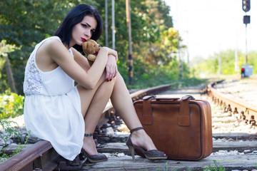 Sad girl on the railway