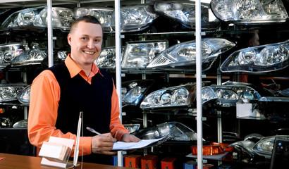 Smiling Salesman Auto Parts Store