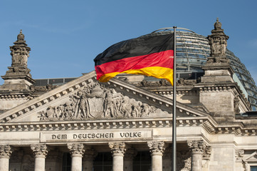 flag of the Federal Republic of Germany is waving in front of the national german parliament, Berlin, Germany,  Europe