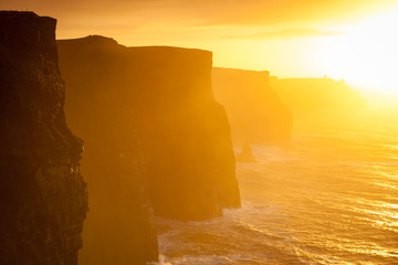 Wall Murals Melon Cliffs of Moher at sunset in Co. Clare Ireland Europe.