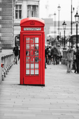 Fotorolgordijn Rood, zwart, wit Traditional old style red telephone box in London