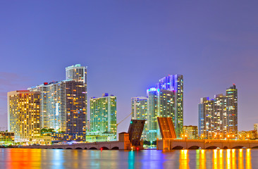 Miami Florida at sunset, colorful skyline of illuminated buildings and Venetian Causeay