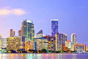 Miami Florida at sunset, colorful skyline of illuminated buildings