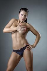 Hot female bodybuilder posing naked to waist
