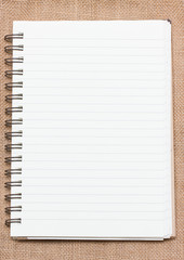 Binder notebook on sack background.