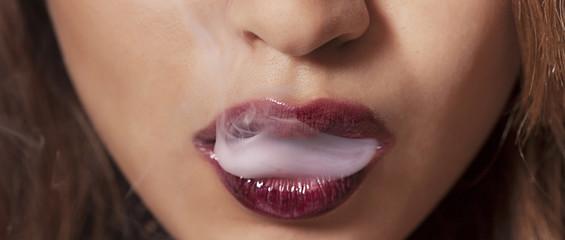 Sexy woman smoking closeup letterbox