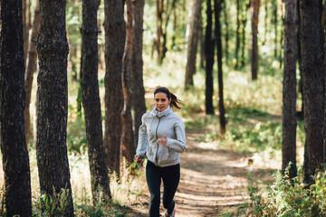 Runner woman jogging in autumn park