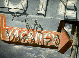 aged and worn vintage photo of neon vacancy sign