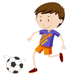 Boy kicing soccer ball