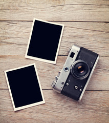 Vintage film camera and two blank photo frames