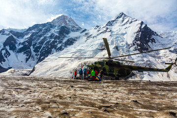 Helicopter Landing on Ice Field of Massive Glacier and People Unloading Luggage