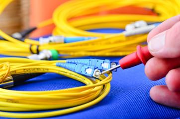 Engineer testing fiber optic cables.