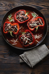 Bell peppers stuffed with ground beef meat in a frying pan