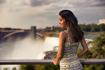 Beautiful woman enjoing the view of Niagara Fall