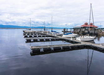 boathouse on the lake with pier and sail boats docked