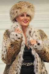 Glamorous woman in fur coat and hat