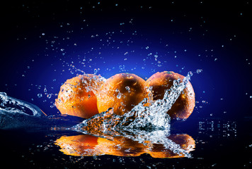 ripe oranges on mirror