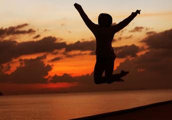 girl jump sunset