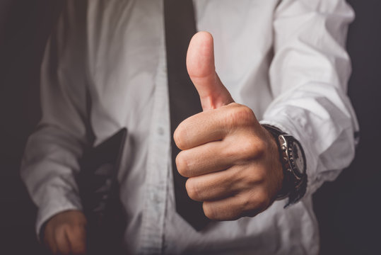 Businessman gesturing thumbs up sign