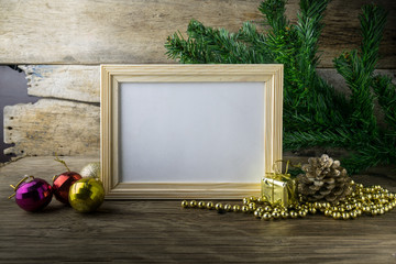 Picture Frame and Christmas decorations on old wooden background