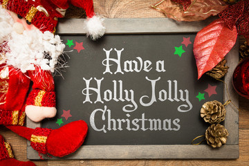 Blackboard with the text: Have a Holly Jolly Christmas in a christmas conceptual image