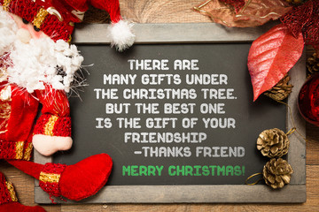 Blackboard with the text about Friendship in a christmas conceptual image